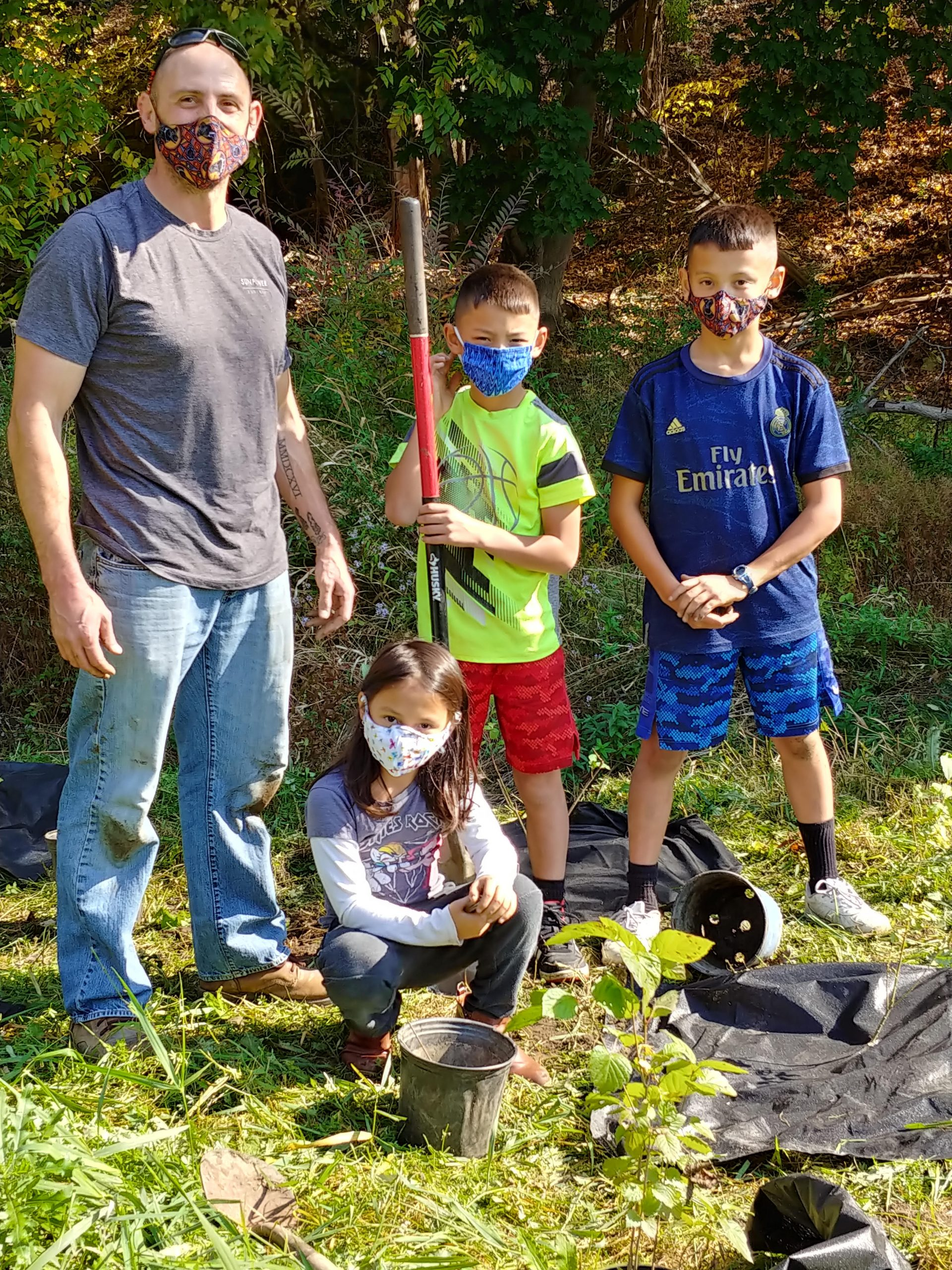 Family at Wells Brook planting day. Photo by William Soja.